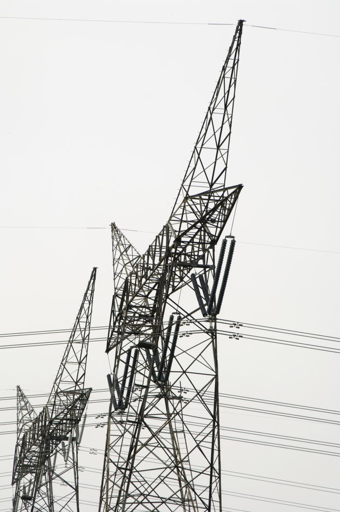 Side view of two electricity pylons